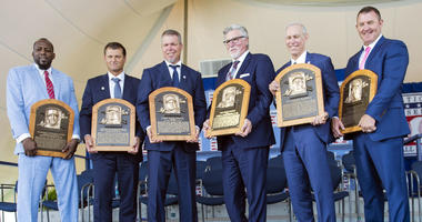 Jul 29, 2018; Cooperstown, NY, USA; Hall of Fame inductees Vladimir Guerrero, Tevor Hoffman, Chipper Jones, Jack Morris, Alan Trammell and Jim Thome pose with their Hall of Fame Plaques at Clark Sports Center.