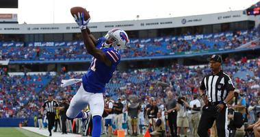 Buffalo Bills wide receiver Rod Streater (81) catches a pass for a touchdown that would be called back for off-setting penalties against the Carolina Panthers during the first quarter at New Era Field.