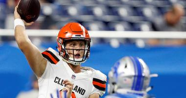 leveland Browns quarterback Brogan Roback (3) passes the ball against Detroit Lions linebacker Chad Meredith (59) during the fourth quarter at Ford Field.