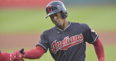 Cleveland Indians shortstop Francisco Lindor (12) celebrates his solo home run in the first inning against the Kansas City Royals at Progressive Field.