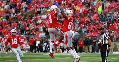 Ohio State Buckeyes wide receiver Terry McLaurin (83) celebrates scoring a touchdown with wide receiver K.J. Hill (14) against the Rutgers Scarlet Knights in the first half at Ohio Stadium.