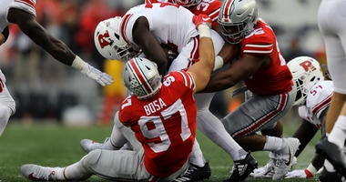 Sep 8, 2018; Columbus, OH, USA; Rutgers Scarlet Knights running back Jonathan Hilliman (23) is tackled by Ohio State Buckeyes defensive end Nick Bosa (97), defensive end Javontae Jean-Baptiste (38), and defensive tackle Dre'Mont Jones (86) in the first ha