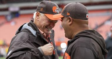 Cleveland Browns owner Jimmy Haslam, left, talks head coach Hue Jackson before the game at FirstEnergy Stadium.