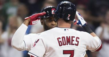 Cleveland Indians third baseman Yandy Diaz (36) salutes catcher Yan Gomes (7) after Gomes hit a two-run home run during the fourth inning against the Boston Red Sox at Progressive Field.