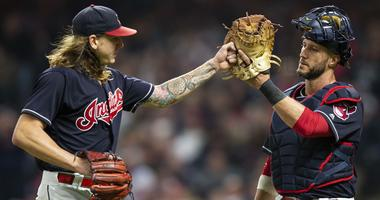 Sep 22, 2018; Cleveland, OH, USA; Cleveland Indians starting pitcher Mike Clevinger (52) high fives catcher Yan Gomes (7) following the third out of the top of the the third inning at Progressive Field.