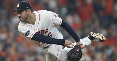 Oct 5, 2018; Houston, TX, USA; Houston Astros starting pitcher Justin Verlander (35) delivers a pitch during the first inning in game one of the 2018 ALDS playoff baseball series against the Cleveland Indians at Minute Maid Park.