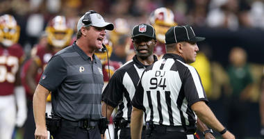 Jay Gruden speaks with head linesman Hugo Cruz (94) in the second quarter against the New Orleans Saints at the Mercedes-Benz Superdome. Mandatory Credit: Chuck Cook-USA TODAY Sports
