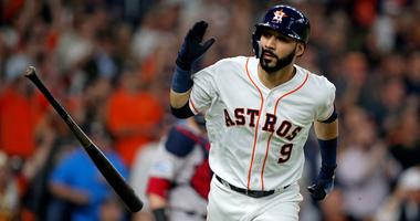 Oct 16, 2018; Houston, TX, USA; Houston Astros left fielder Marwin Gonzalez (9) flips his bat after singling in a run in the first inning against the Boston Red Sox in game three of the 2018 ALCS playoff baseball series at Minute Maid Park. Mandatory Cred