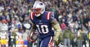 New England Patriots wide receiver Josh Gordon (10) carries the ball during the fourth quarter against the Green Bay Packers at Gillette Stadium.