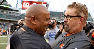 Cincinnati Bengals special assistant to the head coach Hue Jackson (left) talks with Cleveland Browns head coach Gregg Williams (right) after the Browns defeated the Bengals at Paul Brown Stadium.