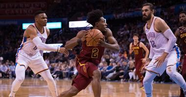 Nov 28, 2018; Oklahoma City, OK, USA; Cleveland Cavaliers guard Collin Sexton (2) drives to the basket past Oklahoma City Thunder guard Russell Westbrook (0) during the second quarter at Chesapeake Energy Arena. Mandatory Credit: Rob Ferguson-USA TODAY Sp
