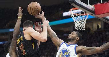 Dec 5, 2018; Cleveland, OH, USA; Golden State Warriors forward Alfonzo McKinnie (28) knocks the ball away from Cleveland Cavaliers forward Larry Nance Jr. (22) during the first half at Quicken Loans Arena. Mandatory Credit: Ken Blaze-USA TODAY Sports