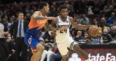 Dec 7, 2018; Cleveland, OH, USA; Sacramento Kings guard Buddy Hield (24) drives to the basket against Cleveland Cavaliers guard Jordan Clarkson (8) during the first half at Quicken Loans Arena. Mandatory Credit: Ken Blaze-USA TODAY Sports