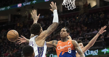 Dec 7, 2018; Cleveland, OH, USA; Cleveland Cavaliers guard Jordan Clarkson (8) passes under Sacramento Kings center Willie Cauley-Stein (00) during the second half at Quicken Loans Arena. Mandatory Credit: Ken Blaze-USA TODAY Sports
