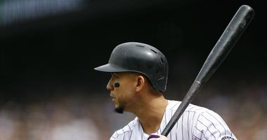 Sep 3, 2018; Denver, CO, USA; Colorado Rockies right fielder Carlos Gonzalez (5) on deck in the first inning against the San Francisco Giants at Coors Field. Mandatory Credit: Isaiah J. Downing-USA TODAY Sports