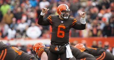 Dec 23, 2018; Cleveland, OH, USA; Cleveland Browns quarterback Baker Mayfield (6) signals to his running backs against the Cincinnati Bengals during the first quarter at FirstEnergy Stadium. Mandatory Credit: Scott R. Galvin-USA TODAY Sports