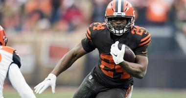 Dec 23, 2018; Cleveland, OH, USA; Cleveland Browns running back Nick Chubb (24) runs with the ball as Cincinnati Bengals cornerback Darius Phillips (23) defends during the second half at FirstEnergy Stadium. Mandatory Credit: Ken Blaze-USA TODAY Sports