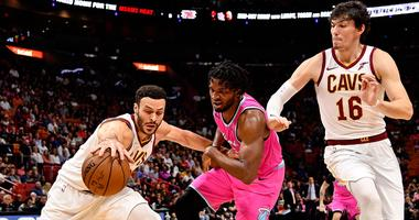 Dec 28, 2018; Miami, FL, USA; Cleveland Cavaliers forward Larry Nance Jr. (22) battles Miami Heat forward Justise Winslow (20) for a loose ball during the first half at American Airlines Arena. Mandatory Credit: Jasen Vinlove-USA TODAY Sports