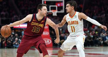 Dec 29, 2018; Atlanta, GA, USA; Cleveland Cavaliers guard Matthew Dellavedova (18) handles the ball against Atlanta Hawks guard Trae Young (11) during the forth quarter at State Farm Arena. Mandatory Credit: Adam Hagy-USA TODAY Sports