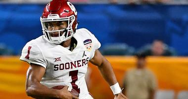 Oklahoma Sooners quarterback Kyler Murray (1) scrambles with the ball against the Alabama Crimson Tide in the 2018 Orange Bowl college football playoff semifinal game at Hard Rock Stadium.