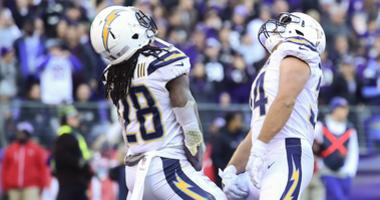 Jan 6, 2019; Baltimore, MD, USA; Los Angeles Chargers fullback Derek Watt (34)  celebrates with running back Melvin Gordon (28) after a fourth quarter touchdown against the Baltimore Ravens in a AFC Wild Card playoff football game at M&T Bank Stadium. Man