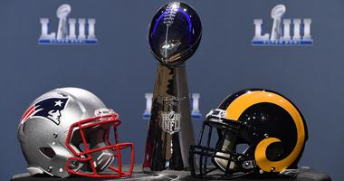The Vince Lombardi Trophy and helmets for the New England Patriots and Los Angeles Rams