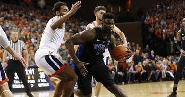 Duke Blue Devils forward Zion Williamson (1) drives to the basket as Virginia Cavaliers guard Braxton Key (2) defends in the first half at John Paul Jones Arena. The Blue Devils won 81-71.