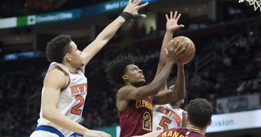 Feb 11, 2019; Cleveland, OH, USA; Cleveland Cavaliers guard Collin Sexton (2) drives to the basket between New York Knicks forward Kevin Knox (20) and guard Dennis Smith Jr. (5) during the second half at Quicken Loans Arena. Mandatory Credit: Ken Blaze-US