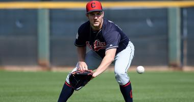 Feb 18, 2019; Goodyear, AZ, USA; Cleveland Indians starting pitcher Trevor Bauer (47) fields a ball during a spring training workout at the Goodyear Ballpark practice fields. Mandatory Credit: Joe Camporeale-USA TODAY Sports