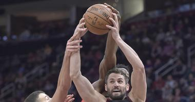 Mar 11, 2019; Cleveland, OH, USA; Cleveland Cavaliers forward Kevin Love (right) rebounds in the second quarter against the Toronto Raptors at Quicken Loans Arena. Mandatory Credit: David Richard-USA TODAY Sports
