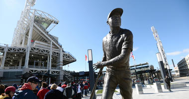 Apr 5, 2016; Cleveland, OH, USA; Fans wait to enter the stadium with a statue of former Cleveland Indians player Larry Doby in the foreground before the game between the Cleveland Indians and the Boston Red Sox at Progressive Field.
