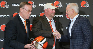Cleveland Browns head coach Freddie Kitchens, center, is congratulated by owner Jimmy Haslam after being introduced by General Manager John Dorsey, left, as the new head coach at a press conference on Monday, Jan. 14, 2019 at FirstEnergy Stadium in Clevel