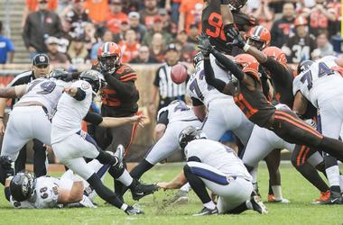 Cleveland Browns cornerback Denzel Ward (21) blocks the field goal attempt of Baltimore Ravens kicker Justin Tucker (9) during the second quarter at FirstEnergy Stadium.
