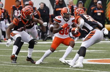 Cleveland Browns wide receiver Jarvis Landry (80) runs against Cincinnati Bengals defensive back Darqueze Dennard (21) and outside linebacker Jordan Evans (50) during the first half at Paul Brown Stadium