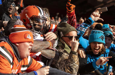 Cleveland Browns fans celebrate with Jarvis Landry after win over the Carolina Panthers