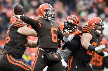 Cleveland Browns quarterback Baker Mayfield (6) throws a pass as Cincinnati Bengals defensive tackle Geno Atkins (97) rushes during the second half at FirstEnergy Stadium.