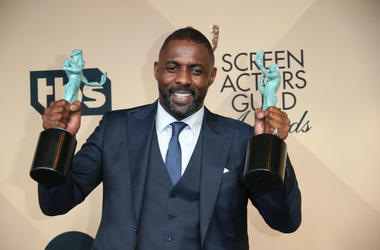 dris Elba poses in the photo room with his awards for Outstanding Performance by a Male Actor in a Supporting Role and Outstanding Performance by a Male Actor in a Television Movie or Miniseries during the 22nd annual Screen Actors Guild Awards at the Shr
