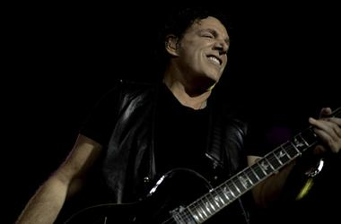 Journey guitarist Neal Schon performs