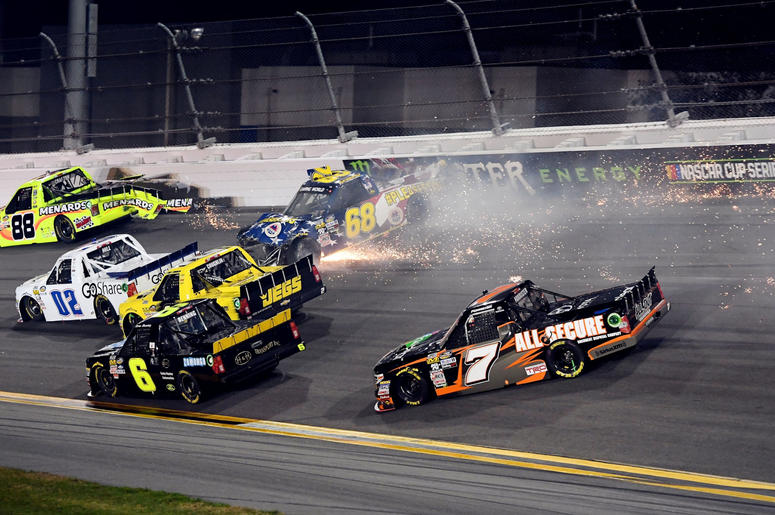 NASCAR Camping World Truck Series driver Clay Greenfield (68) wrecks into turn four with driver Matt Crafton (88) and driver Korbin Forrister (7) during the NextEra Energy Resources 250 at Daytona