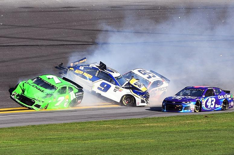 NASCAR Cup Series driver Danica Patrick (7) with driver Chase Elliott (9) and driver Kasey Kahne (95) wreck out of turn three during the Daytona 500 at Daytona International Speedway.