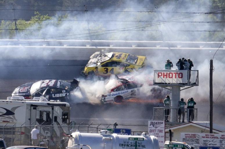 Monster Energy series drivers William Byron (21) Paul Menard (21) and Michael McDowell (34) wreck during the GEICO 500 at Talladega Superspeedway.