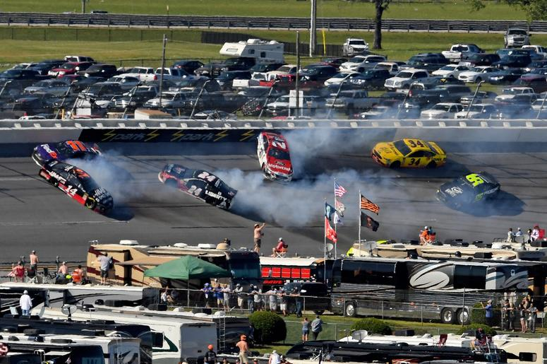 NASCAR Cup Series driver Clint Bowyer (14) wrecks in to driver Denny Hamlin (11) as driver William Bryon (24) and driver Paul Menard (27) spin during the GEICO 500 at Talladega Superspeedway.