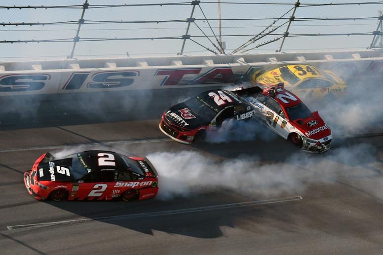 NASCAR NASCAR Cup Series driver Brad Keselowski (2), William Bryon (24), Paul Menard (21), and Michael McDowell (34) wreck during the GEICO 500 at Talladega Superspeedway.