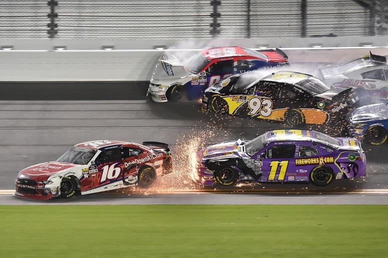 ASCAR Xfinity Series driver Ryan Reed (16) slides in front of Ryan Truex (11) as Josh Williams (90) and Jeff Green (93) wreck during the Coca-Cola Firecracker 250 at Daytona International Speedway.