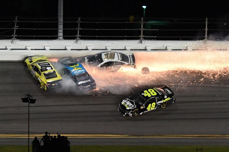 NASCAR Cup Series driver Joey Gase (00), Michael McDowell (34) and Aric Almirola (10) wreck in front of Jimmie Johnson (48) during the Coke Zero Sugar 400 at Daytona International Speedway.