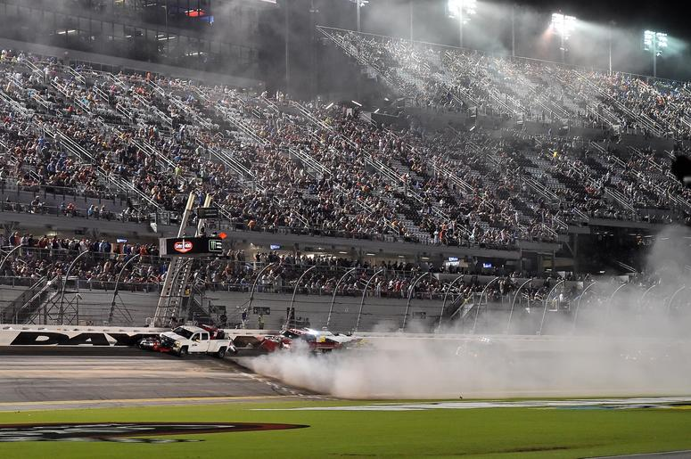 An emergency blows away speedy dry to absorb oil and water left on the track after a wreck during the Coke Zero Sugar 400 at Daytona International Speedway.