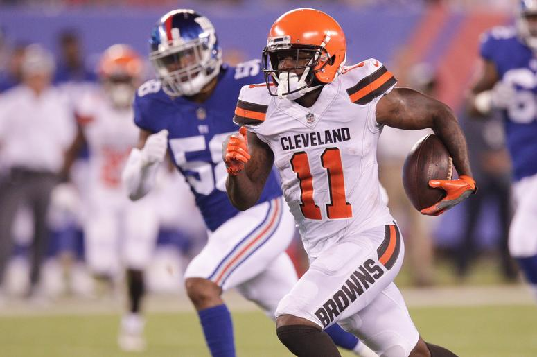 Cleveland Browns wide receiver Antonio Callaway (11) runs for a touchdown after a catch against New York Giants linebacker Tae Davis (58) during the second half at MetLife Stadium.