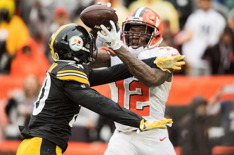 Cleveland Browns wide receiver Josh Gordon (12) catches a touchdown as Pittsburgh Steelers cornerback Cameron Sutton (20) defends during the fourth quarter at FirstEnergy Stadium.