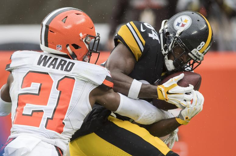 ittsburgh Steelers wide receiver Antonio Brown (84) catches a touchdown as Cleveland Browns cornerback Denzel Ward (21) defends during the third quarter at FirstEnergy Stadium.
