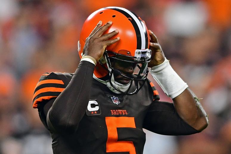 Cleveland Browns quarterback Tyrod Taylor (5) walks to the sideline during the first half of a game against the New York Jets at FirstEnergy Stadium.